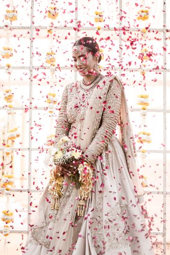 Photo of Pretty bridal portrait with petals thrown