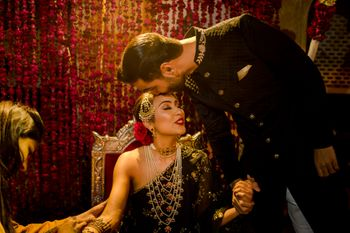 Bride and groom color-coordinating in black for Sufi Night.