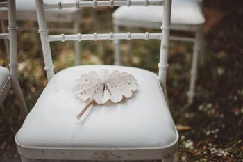 Photo of Wedding guest chairs with fans