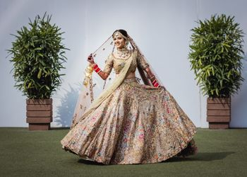 Gold bridal lehenga with colorful details
