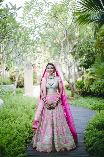Photo of Mint green and pink bridal lehenga