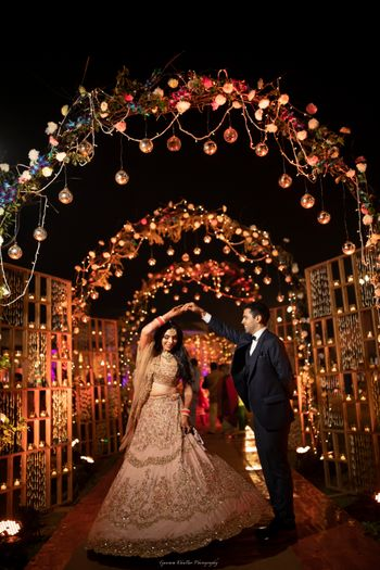 Photo of Sangeet floral decor with dancing couple