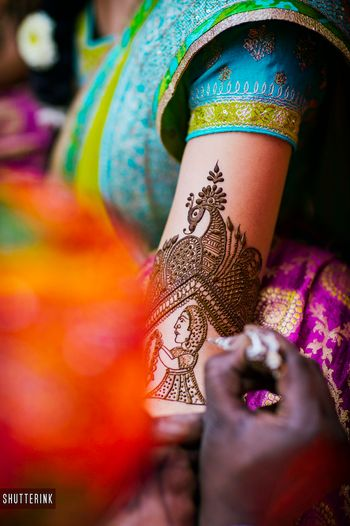 Photo of Unique bridal mehendi design with portrait on arm