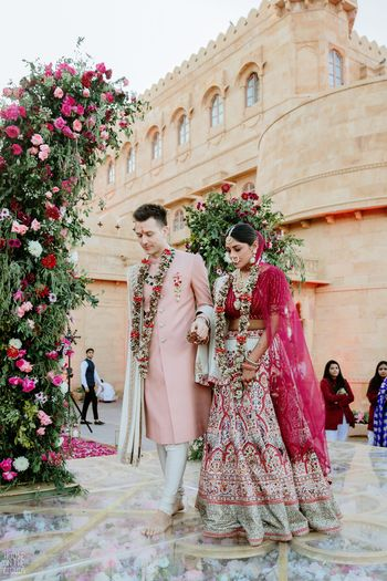 A candid click of the couple right after the jaimala ceremony.
