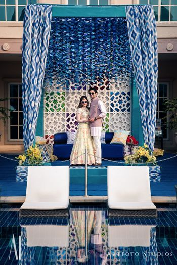 Photo of Unique drape ikat mandap with blue theme