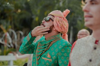 Photo of green sherwani with pastel safa