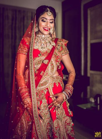 Photo of North indian bride in heavy lehenga and jewellery