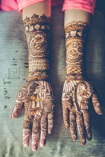 Photo of Modern bridal mehendi with bride and groom portrait