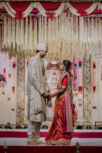 A south indian bride and groom pose in coordinated outfits