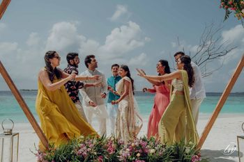 Photo of beach mehendi shot with couple and their friends