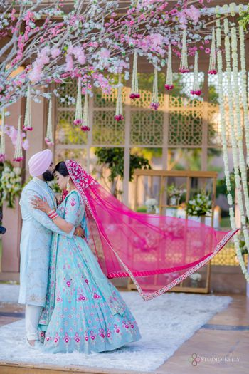 sikh bride and groom in powder blue outfits matching with decor