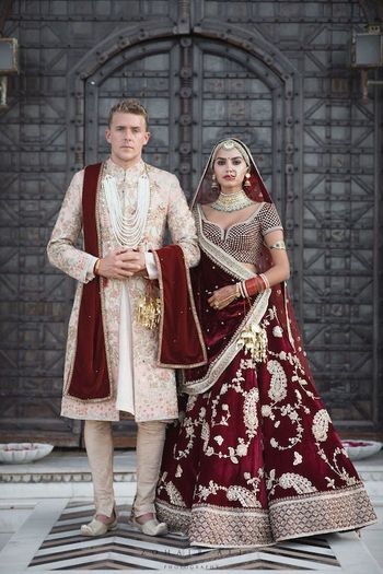 Photo of Matching bride and groom in sabya lehenga