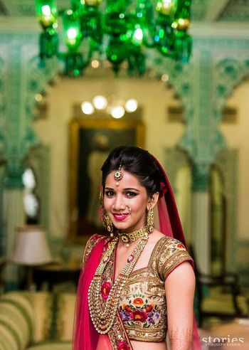 Photo of floral embroidered parsi work gold blouse and red dupatta