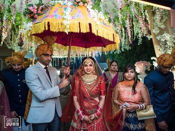 Unique bridal entry idea under umbrella
