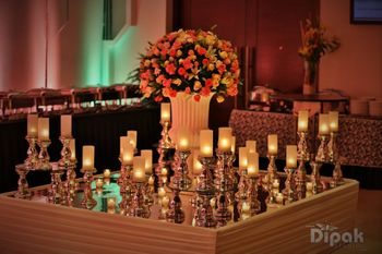 Photo of Table Decor with Floral Arrangement and Candlesticks