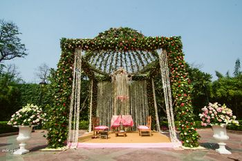 Green mandap decor with leaves