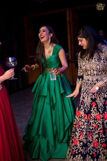 Dark green flared gown for sangeet
