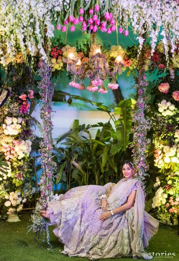 Floral mehendi photobooth with swing and bride
