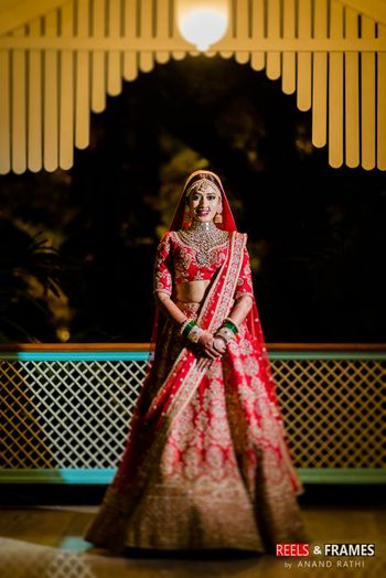 Classic design red and gold bridal lehenga with two dupattas