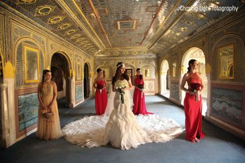 Bridesmaids with Bride wearing Gown with Train