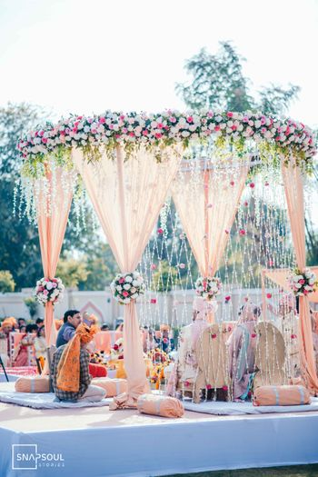 Floral round mandap decor ideas for day wedding.