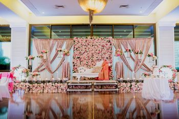 Stage decor with a floral backdrop
