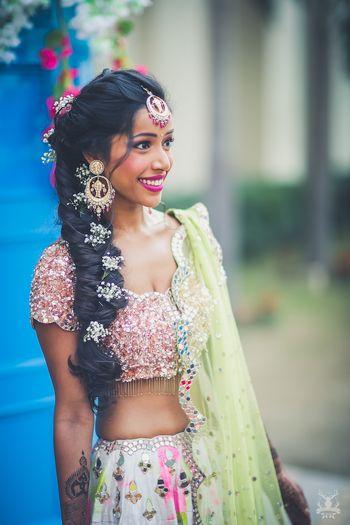 Photo of Disney princess hairstyle with babys breath on mehendi