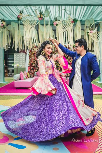 Purple lehenga for engagement with bride twirling