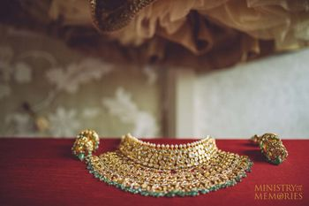 Bridal choker with green beads on display