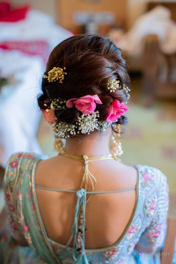 bright pink bridal bun with flowers