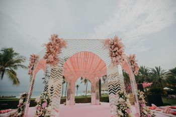 unique mandap decor idea with peach theme and mirrors