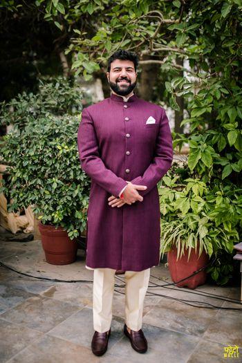 Groom dressed in purple sherwani
