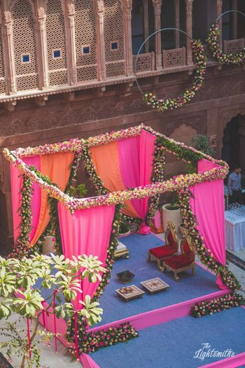 Unique mandap decor with florals and drapes