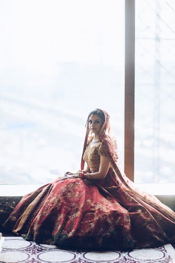 Bridal portrait with lehenga flared out by the window