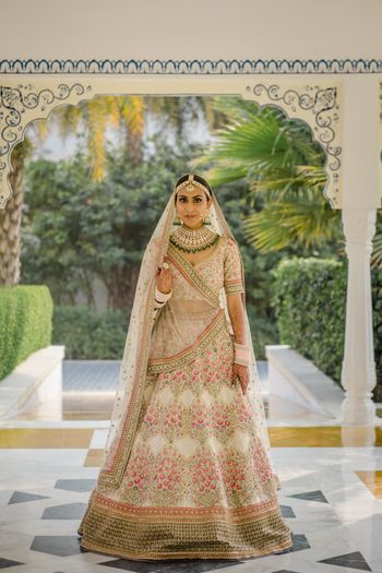 Bride dressed in an ivory lehenga on her wedding day.