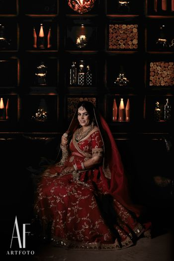 Photo of Red sabyasachi zardozi work lehenga on bride