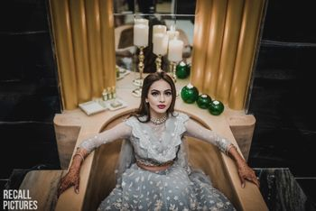 Bride in bathtub getting ready shot