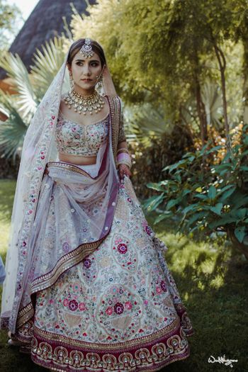 Photo of offbeat floral bridal lehenga in white and maroon