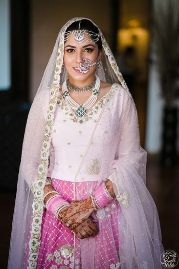 Sikh bride with simple lehenga and unique bridal jewellery