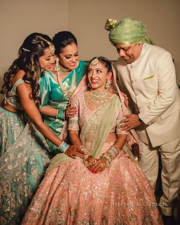 bridal portrait with her mom dad and sister