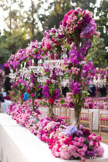 Photo of Floral centrepiece table setting with chandeliers