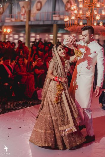 Photo of A bride twirls with her groom