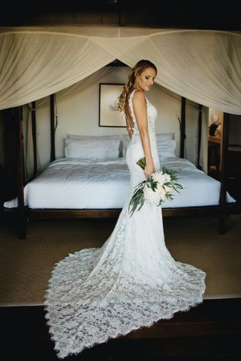 Photo of Lace wedding gown with train