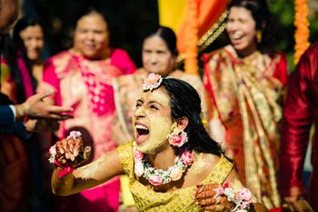 Bride with haldi on her face photo idea