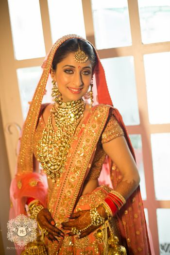 Photo of Layered polki jewellery on Indian bride