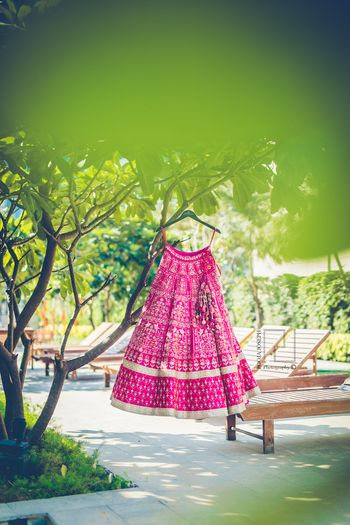 Bright pink and mint bridal lehenga on hanger