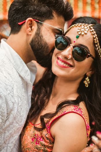 Mehendi couple portrait with bride in shades