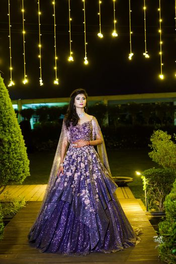 A bride in a purple shimmery gown for her cocktail