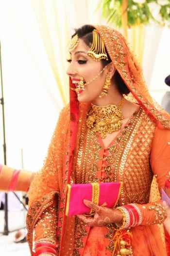 Photo of Candid Bride in Orange Anarkali by Sabyasachi