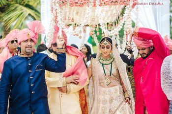 Photo of Bride entering with brothers carrying phoolon ka chadar